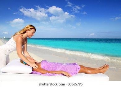 Mayan reiki therapy massage in Caribbean beach with two women