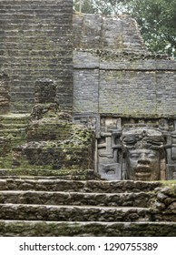 The Mayan temple of Lamanai in Belize, with its Olmec style mask.