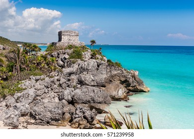 Mayan Temple of the Wind God, perched on a rocky cliff, Tulum, Mexico
