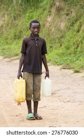 MAYANGE; RWANDA - NOVEMBER 4: Unidentified boy carries a large water jug to get water at November 4; 2013.