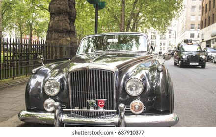 MAYFAIR, LONDON- 6 MAY, 2017: Classic old Bentley car parked next to Berkeley Square, an upmarket district of London