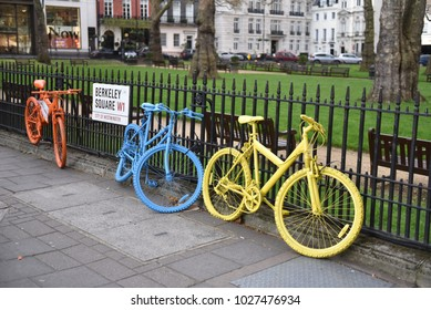 Mayfair, London, UK. 04 APRIL 2017. View of Berkeley Square with the inscription Berkeley Square in the foreground unusual colored bicycles
