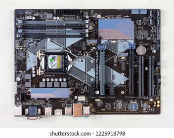 Maykop, Russia - November 9, 2018: Motherboard asus on a gray background closeup top view