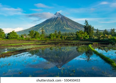 "Mayon Volcano is an active stratovolcano in the province of Albay in Bicol Region, on the island of Luzon in the Philippines. Renowned as the ""perfect cone"" because of its symmetric conical shape"