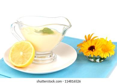 Mayonnaise in bowl on napkin isolated on white
