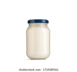 mayonnaise or dressing in bottle on white background