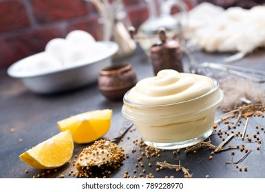 mayonnaise in glass bowl and on a table