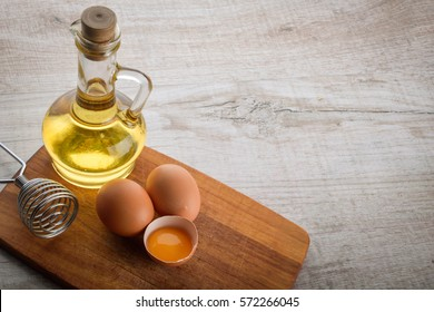 mayonnaise ingredients . oil and eggs on a beautiful tablet on wooden background