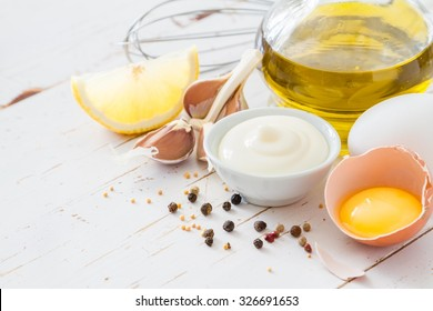 Mayonnaise ingredients on white wood background, copy space