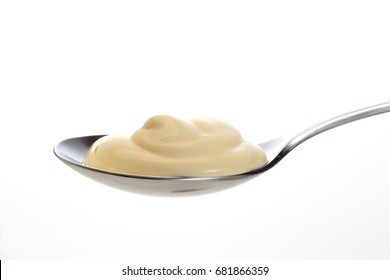 Mayonnaise on spoon, close up