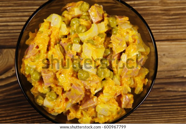 Mayonnaise salad with sausage, green pea, carrot and onion