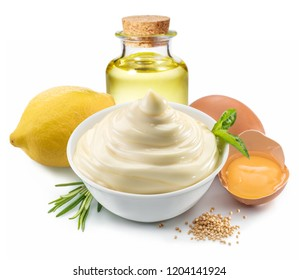 Mayonnaise sauce in white bowl with mayonnaise ingredients on white background.