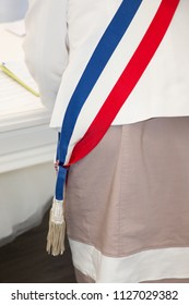 mayor france scarf by woman in France ceremony