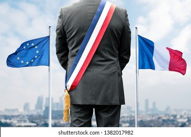 A mayor and the French and European flags