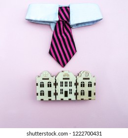 Mayor, the intelligentsia of the city concept. A tie with a white collar above the toy houses of the city, a symbol of management. View from above, flat lay