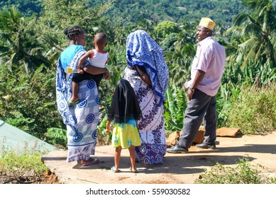 Mayotte, France - 2 June 2007: People with traditional clothes discussing at Mayotte island, France