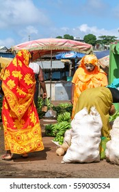 Mayotte, France - 3 June 2007: Woman with traditional clothes discussing at the market of Mayotte island, France