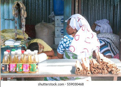 Mayotte, France - 8 June 2007: woman sleeping in her shop at Mayotte island, France