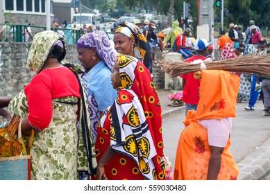 Mayotte, France - 8 June 2007: People with traditional clothes discussing at Mayotte island, France