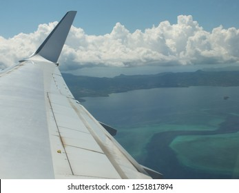 """Mayotte take off, view of the """"passe en s"""" (diving spot)"""