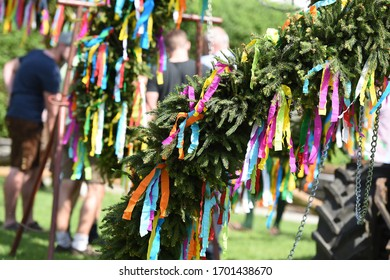 Maypole installation in  Abtsdorf, Attersee (Vöcklabruck district, Upper Austria, Austria) - A maypole is a decorated tree or trunk that will be placed in Austria on May 1 (usually April 30) in the v