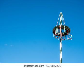 Maypole on blue background