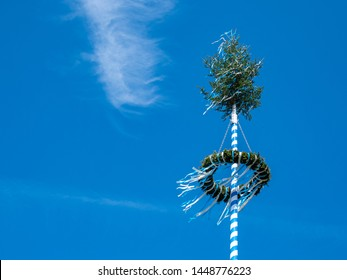 Maypole on a blue background