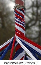 A maypole with ribbons