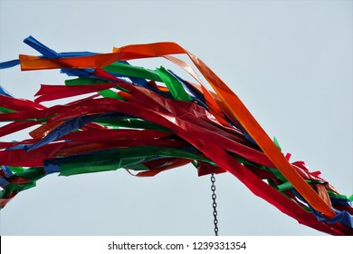 Maypole set-up, customs with a long tradition, Germany. Colorful Ribbons. Beautiful Background.