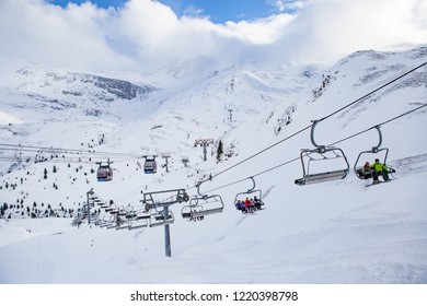 Mayrhofen / Austria - February 03 2014:  Skiers on the cable car in the snowy mountains on the Hintertux Glacier in the Zillertal Valley