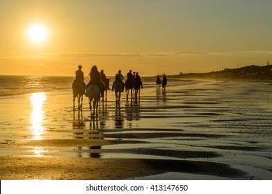 Mazagon beach at sunset , horse riding route , Huelva , Atlantic coast , Spain