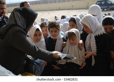 MAZAR - NOVEMBER 1: Kamila, 7, from Chimtal, Balkh, receives a donated uniform November 1, 2009 in Mazar, northern Afghanistan. She was overwhelmed.