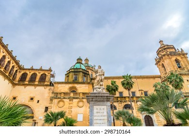 MAZARA DEL VALLO, ITALY - FEBRUARY 22, 2014: day view of main square with San Vito statue and Cathedral dome in Mazara del Vallo, Italy. Mazara port gives shelter to the largest fishing fleet in Italy