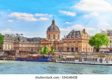 Mazarin Library (Bibliotheque Mazarine) and  Bridge of the Arts ( Pont des Arts) in Paris. France.