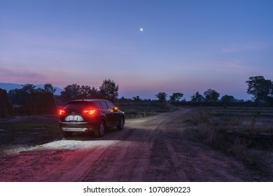 Mazda CX-5 2016 parked on the street wilderness, To watch the sky before sunrise. By the sky with a crescent moon, Lalu, Ta Phraya, Sa Kaeo, Thailand. 05:22 AM, 13 April 2018.