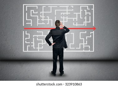 Maze and business man thinking solution