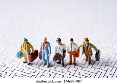 Maze and a group of miniature businessmen
