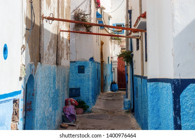 Maze of old narrow streets and alleys in the Kasbah of the Udayas with blue and white painted houses. The Kasbah of the Udayas is a major tourist attraction of Rabat. Morocco.