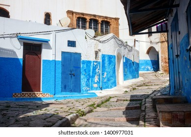 Maze of old narrow streets, stairs and alleys in the Kasbah of the Udayas with blue and white painted houses. The Kasbah of the Udayas is a major tourist attraction of Rabat. Morocco.
