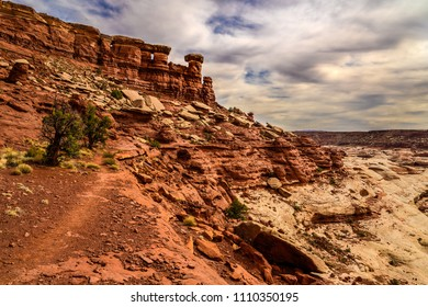The Maze Overlook Trail in this remote area of Canyonlands National park in Utah,  steeply descends from the rim above into a spectacular desert of beautiful canyons and rock formations.