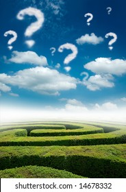 A maze under a blue sky with question mark clouds.