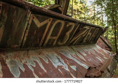 MAZIRBE, LATVIA - AUGUST 31, 2019: Name of town Mazirbe written in Cyrillic on fishing boats' remnants in Mazirbe Boat Cemetary, which was created in 1960s.
