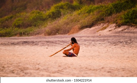 Mazunte, Oaxaca, Mexico - January, 24th, 2018: man on the beach playing didgeridoo at Mermejita beach