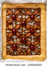 Mazurek pastry, traditional Polish Easter cake made of shortcrust pastry,  fudge caramel cream, candied fruit and almonds, top view. Easter treat