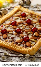 Mazurek pastry, traditional Polish Easter cake made of shortcrust pastry,  fudge caramel cream, candied fruit and almonds, close up. Easter treat
