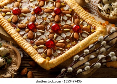 Mazurek pastry, traditional Polish Easter cake made of shortcrust pastry,  fudge caramel cream, candied fruit and almonds, top view, close-up. Very sweet dessert, Easter treat