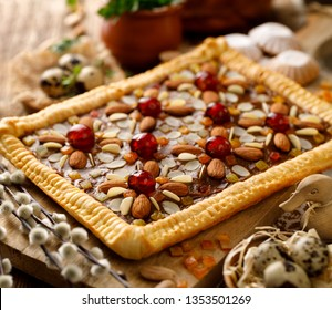 Mazurek pastry, traditional Polish Easter cake made of shortcrust pastry,  fudge caramel cream, candied fruit and almonds, close-up. Very sweet dessert, Easter treat