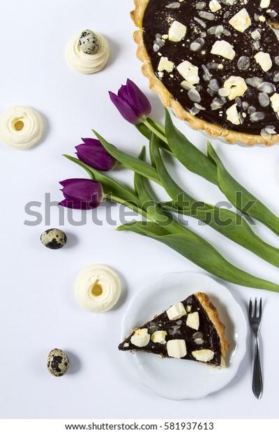 Mazurek- traditional Easter cake from Poland. White background, tulips.