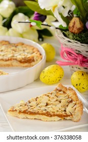 Mazurek -traditional easter polish pie and easter decorations on the table.