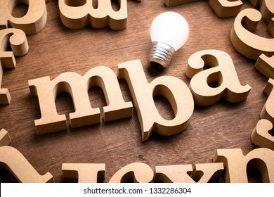 MBA in lower case font with glowing light bulb, Learning MBA or Master of Business Administration concept